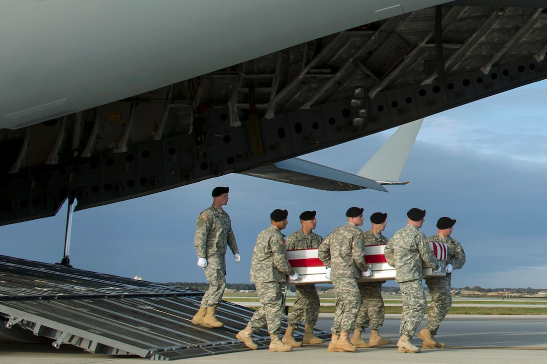 An Army carry team moves the transfer case of U.S. Army Master Sgt. Joshua L. Wheeler during the dignified transfer of his remains at Dover Air Force Base, Del., Oct. 24, 2015. DoD photo by Air Force Senior Master Sgt. Adrian Cadiz