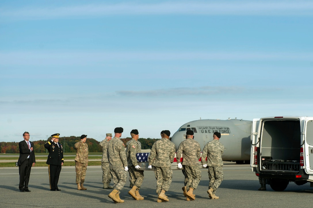 Defense Secretary Ash Carter and Army Chief of Staff  Gen. Mark A. Milley salute as an Army carry team moves the transfer case of U.S. Army Master Sgt. Joshua L. Wheeler during the dignified transfer of his remains at Dover Air Force Base, Del., Oct. 24, 2015. DoD photo by Air Force Senior Master Sgt. Adrian Cadiz