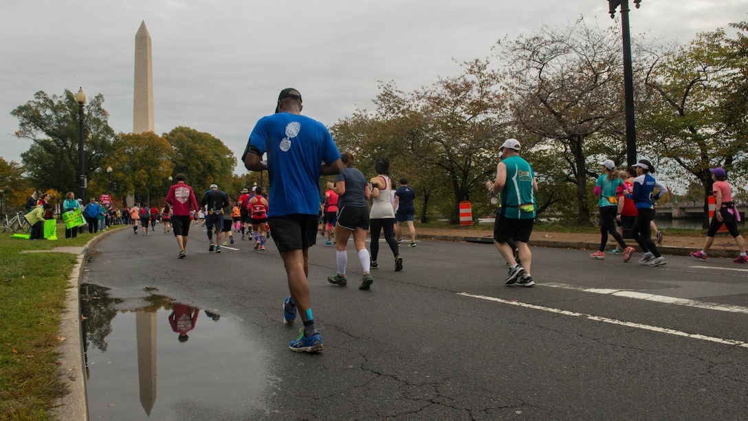 """Runners race through Washington during the Marine Corps Marathon, Oct. 25, 2015. More than 30,000 runners dashed 26.2 miles through Washington and Arlington, Virginia, during this year's race, which marked the 40th running of the """"The Peoples Marathon."""""""