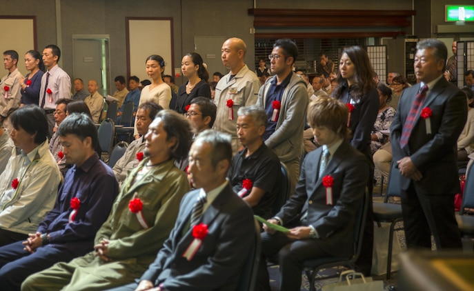 Station and city officials recognized Japanese civilians during a Length of Service Award Ceremony at the Club Iwakuni ballroom for their work and dedication at Marine Corps Air Station Iwakuni, Japan, Oct. 22, 2015. The Length of Service Award Ceremony recognizes the Japanese civilian's dedication and passion while working on the installation. The attendees continuously contribute to building and maintaining trust between the U.S. and Japan by giving extra effort in in their duties that help the air station operate smoothly.