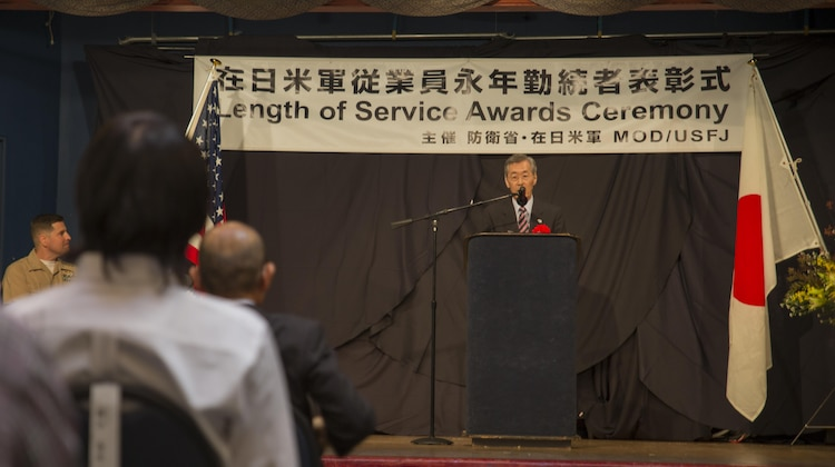Yoshihiko Fukuda, Mayor of Iwakuni City, addresses attendees during the Length of Service Award Ceremony at the Club Iwakuni ballroom at Marine Corps Air Station Iwakuni, Japan, Oct. 22, 2015. The Length of Service Award Ceremony recognizes the Japanese civilian's dedication and passion while working on the installation. Station and city officials expressed their appreciation towards the attendees for their efforts and contribution to the air station.