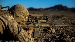 A Marine with 1st Battalion, 8th Marine Regiment pauses as he fires during the sniper marksmanship assessment as part of Integrated Training Exercise 1-16 aboard Marine Air Ground Combat Center, Twentynine Palms, Calif., Oct. 24, 2015. During ITX, Marines demonstrate core infantry mission essential tasks while conducting offensive and defensive stability operations. (U.S. Marine Corps photo by Cpl. Immanuel M. Johnson/Released)