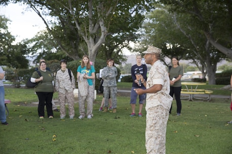 Col. Sekou S. Karega, Commanding Officer of Marine Corps Logistics Base Barstow, addresses Marine and Army spouses at the beginning of Jane Wayne Day aboard MCLB, October 15.  The is designed for spouses to spend the day as a Marine and included activities at the base obstacle course, rifle range, and maintenance facilities.