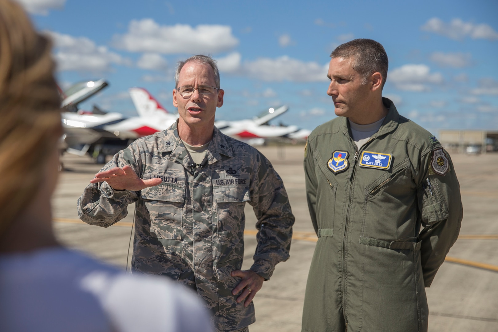 Brig. Gen. Bob Labrutta,502nd Air Base Wing and Joint Base San Antonio commander and Col. Mathew Isler, 12th Flying Training Wing commander, answer questions from the media at Joint Base San Antonio-Randolph prior to the 2015 Joint Base San Antonio Air Show and Open House Oct. 26, 2015.  Air shows allow the Air Force to display the capabilities of our aircraft to the American taxpayer through aerial demonstrations and static displays.  Randolph's air show allowed attendees to get up close and personal to see some of the equipment and aircraft used by the U.S. military today.