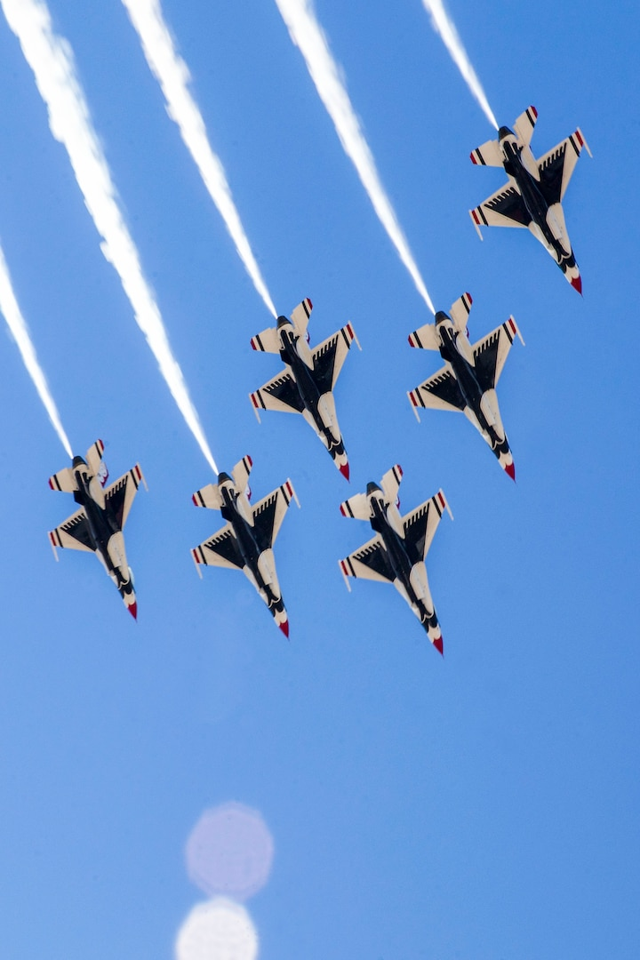 """The U.S. Air Force Aerial Demonstration Squadron """"Thunderbirds"""" team members arrive at Joint Base San Antonio-Randolph prior to the 2015 Joint Base San Antonio Open House Oct. 26, 2015.  Air shows allow the Air Force to display the capabilities of our aircraft to the American taxpayer through aerial demonstrations and static displays.  Randolph's air show allowed attendees to get up close and personal to see some of the equipment and aircraft used by the U.S. military today. (U.S. Air Force by Joshua Rodriguez/Released)"""