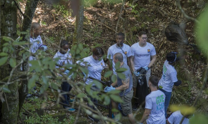 Station Volunteers look for trash at Futashika Umezu Falls, in Futashika, Yamaguchi Prefecture, Japan, Oct. 16, 2015. The Single Marine Program at Marine Corps Air Station Iwakuni, Japan, provides residents volunteer opportunities to build relations with Japanese locals and experience part of the foreign culture. Station residents share the environment with the community and are taking necessary precautions to prevent adverse effects on the environment and habitat.