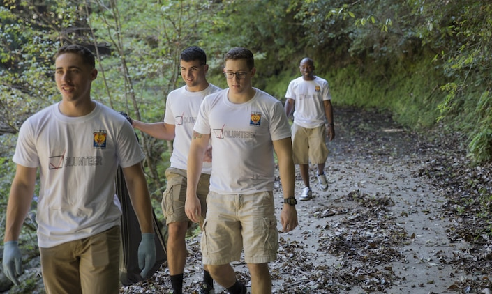 Station Volunteers look for trash at Futashika Umezu Falls, in Futashika, Yamaguchi Prefecture, Japan, Oct. 16, 2015. The Single Marine Program at Marine Corps Air Station Iwakuni, Japan, provides residents volunteer opportunities to build relations with Japanese locals and experience part of the foreign culture.  Volunteers enjoyed the scenery of the forest, river and waterfalls, as they picked up trash and debris along the river.