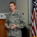 Oregon Air National Guard Col. Adam Sitler, 142nd Fighter Wing Operations Group (OPS) commander, discusses the expanded mission of the OPS group, Portland Air National Guard Base, Ore., Sept. 18, 2015. (U.S. Air National Guard photo by Tech. Sgt. John Hughel, 142nd Fighter Wing Public Affairs/released)