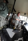 Prior to become the 142nd Fighter Wing Command Chief Master Sergeant, Chief Master Sgt. Chris Roper was the senior enlisted advisor for the Combat Operations Group. Roper assisted a base tour on Dec. 14, 2014, helping drive and shuttle visitors as a bus driver, Portland Air National Guard Base, Ore. (U.S. Air National Guard photo by Tech. Sgt. John Hughel, 142nd Fighter Wing Public Affairs)