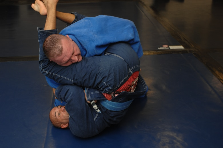 Leo Pavlushkin, 355th Security Force Squadron lead police officer, grapples with Garrett Clark, Air Force veteran and jiujitsu instructor during a Brazilian jiujitsu class at Davis-Monthan Air Force Base, Ariz., Sept. 30, 2015. The class is held Monday, Wednesday and Friday at 4:30 p.m. in the upstairs of the Airman Leadership School building 4455. (U.S. Air Force photo by Airman Basic Nathan H. Barbour/Released)
