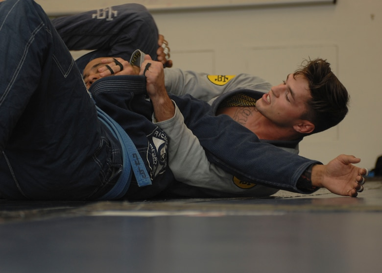 U.S. Air Force Senior Airman Jeremiah Garber, 355th Maintenance Group analyst, spars with Garrett Clark, Air Force veteran and jiujitsu instructor, during Brazilian Jujitsu class at Davis-Monthan Air Force Base, Ariz., Sept. 30, 2015. Jiujitsu consists of two submissions; joint manipulation and chokes; there's no striking and throwing is frowned upon. (U.S. Air Force photo by Airman Basic Nathan H. Barbour/Released)