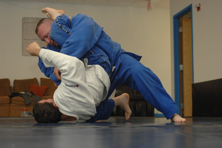 Leo Pavlushkin, 355th Security Forces Squadron lead police officer, grapples with Jariel Rivera, 355th Maintenance Group squadron lead crew member, during a Brazilian jiujitsu class at Davis-Monthan Air Force Base, Ariz., Sept. 30, 2015. The class is held Monday, Wednesday and Friday at 4:30 p.m. in the upstairs of the Airman Leadership School building 4455. (U.S. Air Force photo by Airman Basic Nathan H. Barbour/Released)