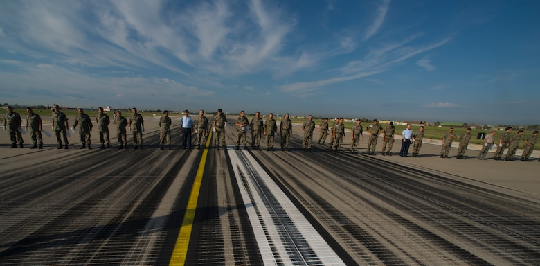 U.S. Airmen from the 39th Air Base Wing worked with Turkish airmen from the 10th Tanker Base Command, to rid the flight line of foreign object debris Oct. 8, 2015, Incirlik Air Base, Turkey. The FOD walk is an annual joint effort to ensure incoming and outgoing aircraft are not damaged by debris. (U.S Air Force photo by Staff Sgt. Eboni Reams/Released)