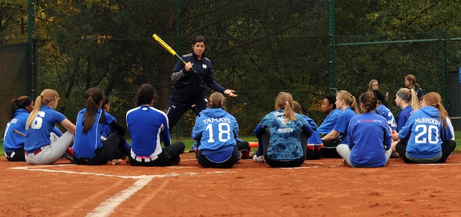 Lizzy Ristano, University of Notre Dame associate softball coach, gives instructions to members of the Ramstein High School Royals varsity softball team Oct. 21, 2015, at Ramstein Air Base, Germany. The Notre Dame coaching staff and players held an instructional softball clinic, a scrimmage and a question and answer session during their visit to the base. (U.S. Air Force photo/Staff Sgt. Sharida Jackson)