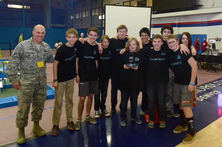 Col. Romberger, 460th Space Wing vice commander, awarded Denver School of Science and Technology Byers Middle School the Most Robust Machine Oct. 24, 2015, at Auraria Campus Events Center, Denver. Romberger attended the Rocky Mountain BEST Robotics Competition in order to show support for a program that encourages Denver youth to participate and gain interest in projects involving engineering, science and technology. (U.S. Air Force photo by Airman 1st Class Luke W. Nowakowski/Released)