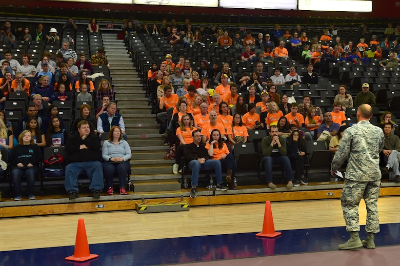 Col. Romberger, 460th Space Wing vice commander, address the crowd that attended the Rocky Mountain Boosting Engineering, Science and Technology Robotics Competition Oct. 24, 2015, at the Auraria Campus Events Center, Denver. Romberger attended the Rocky Mountain BEST Robotics Competition in order to show support for a program that encourages Denver youth to participate and gain interest in projects involving engineering, science and technology. (U.S. Air Force photo by Airman 1st Class Luke W. Nowakowski/Released)