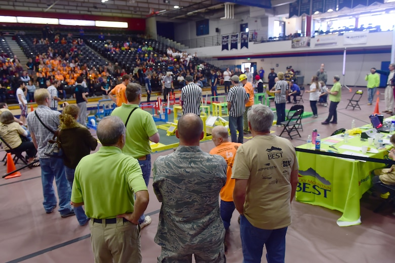 Col. Romberger, 460th Space Wing vice commander, looks on as teams compete during the Rocky Mountain Boosting Engineering, Science and Technology Robotics Competition Oct. 24, 2015, at the Auraria Campus Events Center, Denver. Romberger attended the Rocky Mountain BEST Robotics Competition in order to show support for a program that encourages Denver youth to participate and gain interest in projects involving engineering, science and technology. (U.S. Air Force photo by Airman 1st Class Luke W. Nowakowski/Released)
