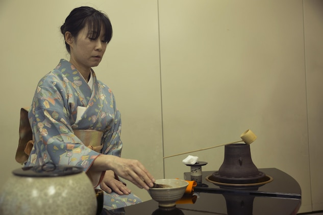 Ruriko Nishimoto, an instructor with the Omotesenke Tea Ceremony Club, demonstrates how to prepare green tea during a tea ceremony hosted by the Cultural Adaptation Program at Marine Corps Air Station Iwakuni, Japan, Oct. 17, 2015. Participants learned tea customs and courtesies helping them become more assimilated to Japanese culture.