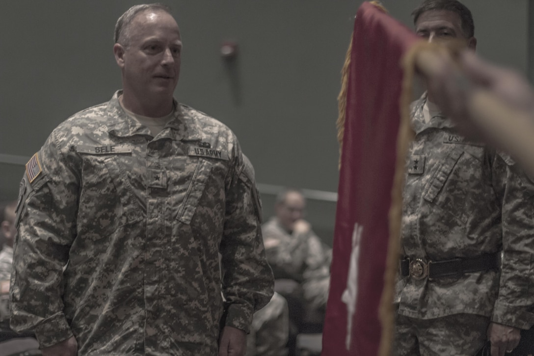The one-star flag is unfurled for Brig. Gen. Richard Sele at his promotion ceremony hosted by Maj. Gen. Daniel Ammerman, U.S. Army Civil Affairs and Psychological Operations Command (Airborne) commanding general, at the Airborne and Special Operations Museum in Fayetteville, N.C., Oct. 25, 2015. Sele, a longtime Soldier with USACAPOC, takes over for Brig. Gen. A. Ray Royalty as the 108th Training Command (IET), deputy commanding general. (U.S. Army photo by Sgt. 1st Class Brian Hamilton)