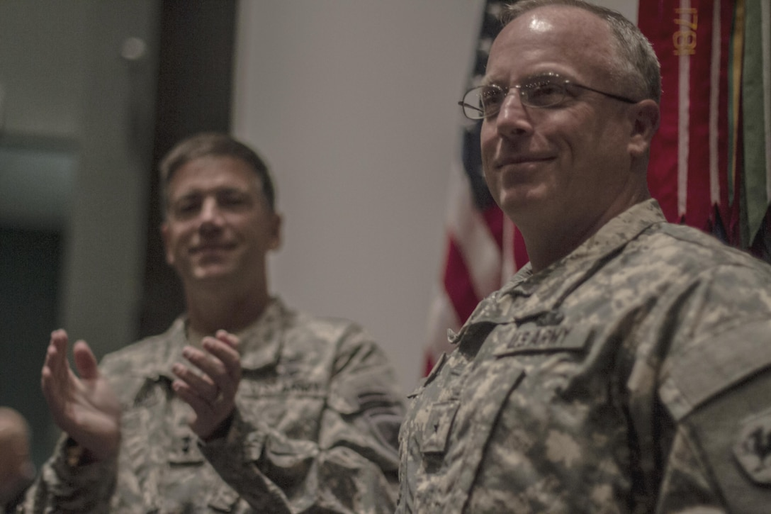 Maj. Gen. Daniel Ammerman, United States Army Civil Affairs and Pychological Operations Command commanding general, leads the applause for Brig. Gen. Richard Sele, 108th Training Command (IET) deputy commanding general, after  promoting him to general officer. Ammerman hosted the ceremony at the Airborne and Special Operations Museum in Fayetteville, N.C., Oct. 25, 2015. Sele, a longtime civil affairs Soldier, takes over for Brig. Gen. A. Ray Royalty as the deputy commanding general of the 108th, headquartered in Charlotte, N.C. (U.S. Army photo by Sgt. 1st Class Brian Hamilton)