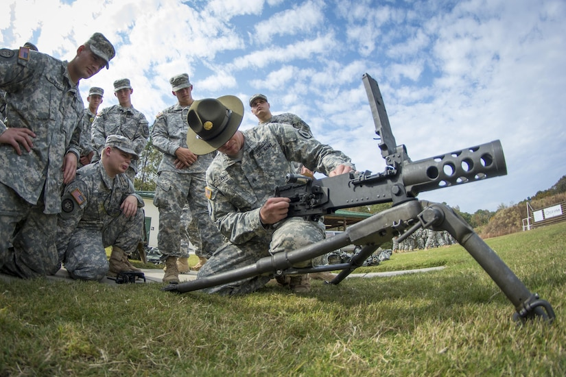 Army Reserve drill sergeant, Sgt. Larry Davis, of Greer, S.C., of 1st Bn., 518th Inf. Reg., 2nd Bde., 98th Training Div. (IET), teaches a group of Clemson University Reserve Officer Training Corps cadets how to pull apart a Browning M2 .50-caliber machine gun as part of a leadership training exercise in the Clemson Forest, Oct. 24, 2015. (U.S. Army photo by Sgt. Ken Scar)