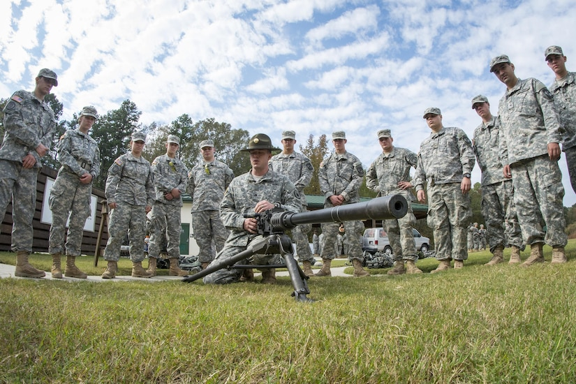 Army Reserve drill sergeant, Sgt. Larry Davis, of Greer, S.C., who is in 1st Bn., 518th Inf. Reg., 2nd Bde., 98th Training Div. (IET), teaches a group of Clemson University Reserve Officer Training Corps cadets how to pull apart a Browning M2 .50-caliber machine gun as part of a leadership training exercise, Oct. 24, 2015. (U.S. Army photo by Sgt. Ken Scar)