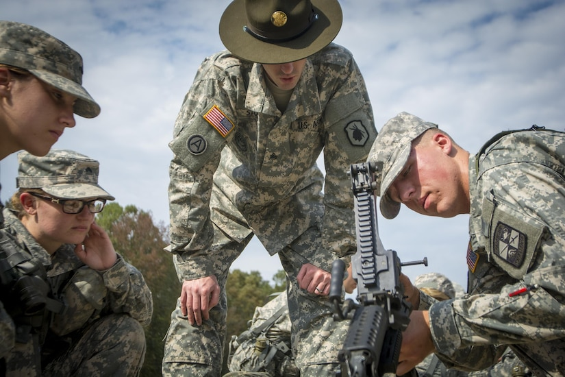 Army Reserve drill sergeant, Sgt. Steven Stowe, of Anderson, S.C., who serves with 1st Bn., 518th Inf. Reg., 2nd Bde., 98th Training Div. (IET), 108th Training Command (IET), teaches a group of Clemson University Reserve Officer Training Corps cadets how to disassemble an M249 light machine gun as part of a three-day leadership training exercise conducted by the Clemson ROTC and the 108th, Oct. 24, 2015. (U.S. Army photo by Sgt. Ken Scar)
