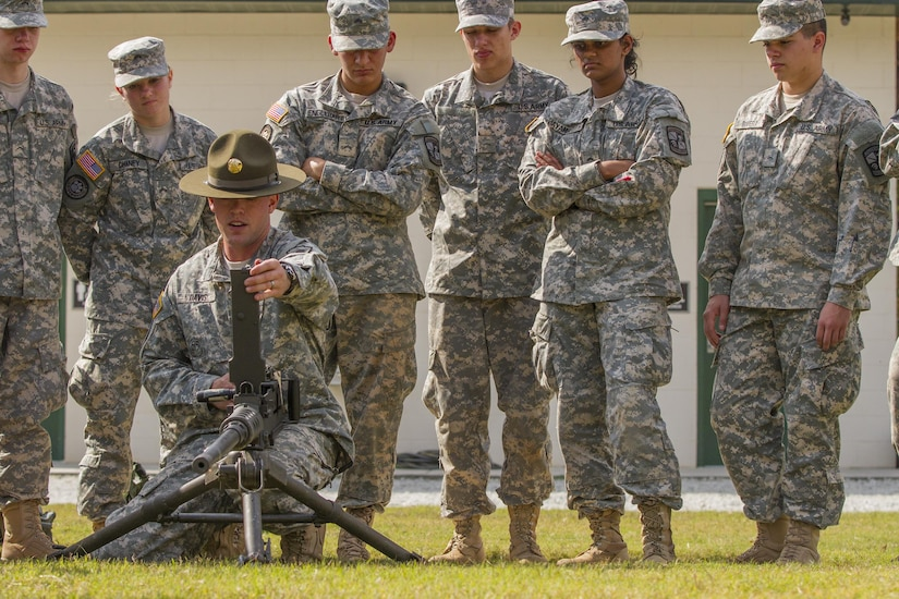 Army Reserve drill sergeant, Sgt. Larry Davis, of Greer, S.C., who is in 1st Bn., 518th Inf. Reg., 2nd Bde., 98th Training Div. (IET), teaches a group of Clemson University Reserve Officer Training Corps cadets how to operate a Browning M2 .50 caliber machine gun as part of a leadership training exercise conducted by the Clemson ROTC and a contingent of 20 personnel from the 108th Training Command (IET), Oct. 24, 2015. (U.S. Army photo by Sgt. Ken Scar)