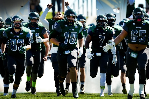 The Eastern New Mexico University Greyhounds take to the feild during a military appreciation game at Blackwater Draw Stadium Oct. 24, 2015, in Clovis, N.M. After four quarters of play, the Greyhounds emerged victorious over the Angelo State University Rams 46-28 for their final game at Blackwater Draw. (U.S. Air Force photo/Staff Sgt. Matthew Plew)