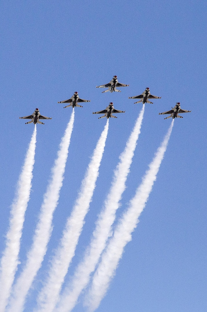 """The U.S. Air Force Aerial Demonstration Squadron """"Thunderbirds"""" practice performing F-16 acrobatic maneuvers Oct. 26, 2015 at Joint Base San Antonio-Randolph, Texas. The Thunderbirds team members arrived in preparation for the 2015 JBSA-Randolph Air Show and Open House to be held Oct. 31 and Nov. 1.  Air shows allow the Air Force to display the capabilities of our aircraft to the American taxpayer through aerial demonstrations and static displays and allowing attendees to get up close and personal to see some of the equipment and aircraft used by the U.S. military today.  (U.S. Air Force photo by Johnny Saldivar/Released)"""