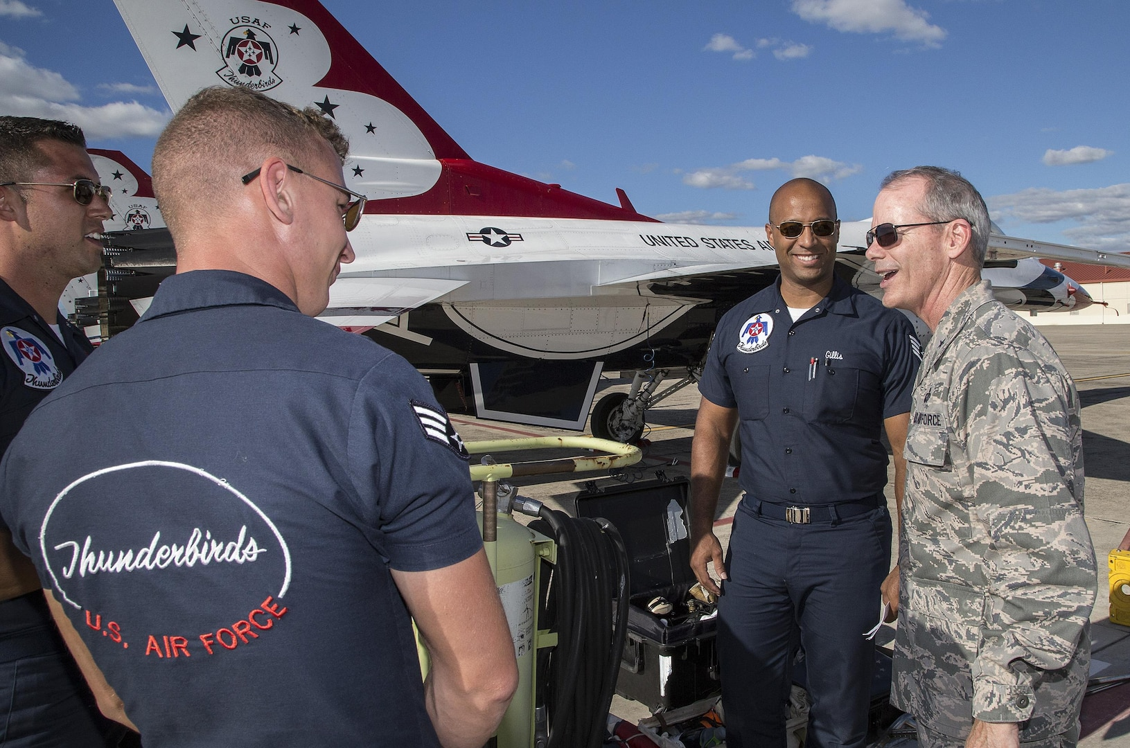 """Brig. Gen. Bob LaBrutta, 502nd Air Base Wing and Joint Base San Antonio commander, visits with U.S. Air Force Air Demonstration Squadron """"Thunderbirds"""" team members Oct. 26, 2015 at Joint Base San Antonio-Randolph, Texas. The Thunderbirds are performing in the 2015 Air Show and Open House to be held at JBSA- Randolph Oct. 31 and Nov. 1. (U.S. Air Force photo by Johnny Saldivar/Released)"""