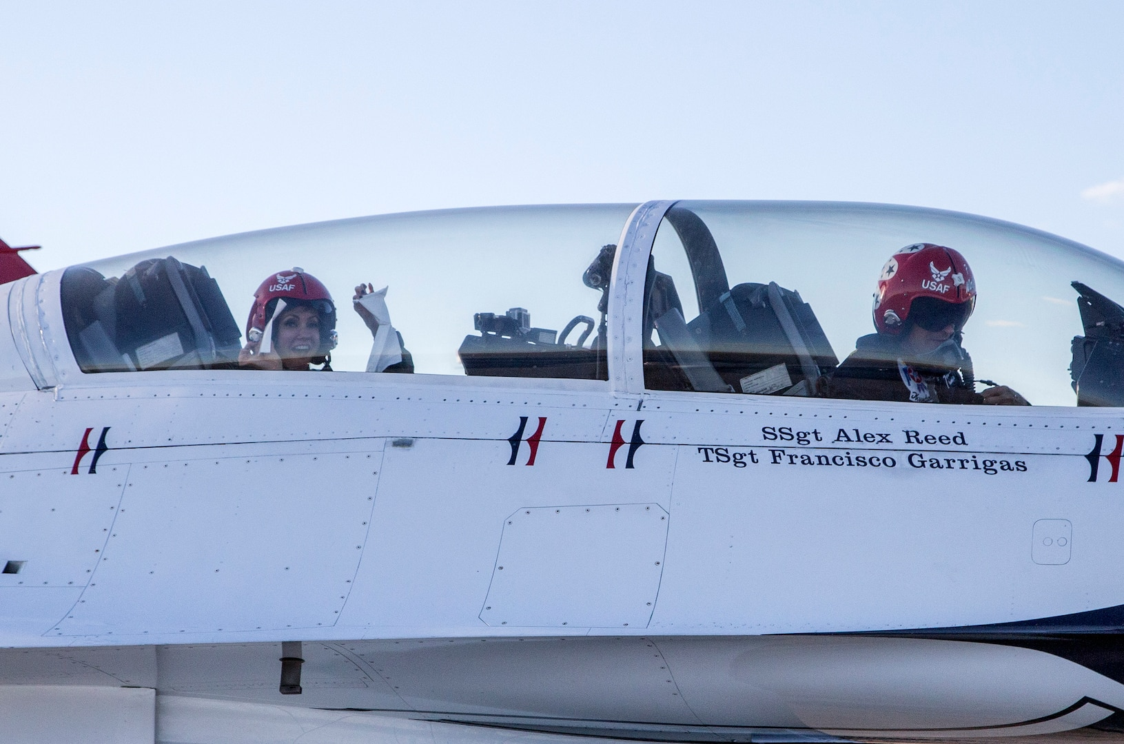 """Maj. Tyler Ellison, U.S. Air Force Air Demonstration Squadron """"Thunderbirds"""" operations officer, prepares to depart with passenger Delaine Mathieu, News 4 San Antonio co-anchor, for a media flight Oct. 26, 2015 at Joint Base San Antonio-Randolph, Texas. The Thunderbirds are performing in the 2015 Air Show and Open House to be held at JBSA-Randolph Oct. 31 and Nov. 1. (U.S. Air Force photo by Johnny Saldivar/Released)"""