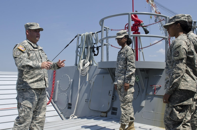 Sgt. 1st Rodney Buras from New Orleans, La., familiarizes Pvt. Keonna Dunkley, Prince Georges County, Va., (left) and Pfc. Aleeya Smith (right) Soldiers with a Landing Craft Mechanized watercraft (LCM). The 3rd Transportation Brigade (Expeditionary) Soldiers were on Fort Eustis during annual training taking part in Terminal Warrior 2015. The Logistics-Over-the-Shore (LOTS) exercise took place in the Hampton Roads area of Virginia from mid July through mid August and included Reserve, National Guard and active duty units focused on cohesion and sharpening proficiency in basic LOTS skills as part of the Total Army Concept.