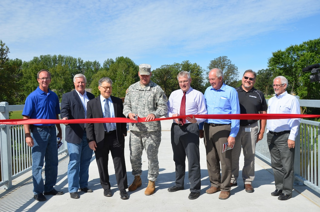 ROSEAU, Minn. - From left, state Rep. Dan Fabian, U.S. Rep. Collin Peterson, U.S. Sen. Al Franken, St. Paul District Commander Col. Dan Koprowski, Roseau, Minn., Mayor Jeffry Peolowski, state Sen. LeRoy Stumpf, Mark Karl of Polaris Industries, and Minnesota Department of Natural Resources representative Kent Lokkesmoe, dedicated the Roseau Flood Risk Management project Aug.18.