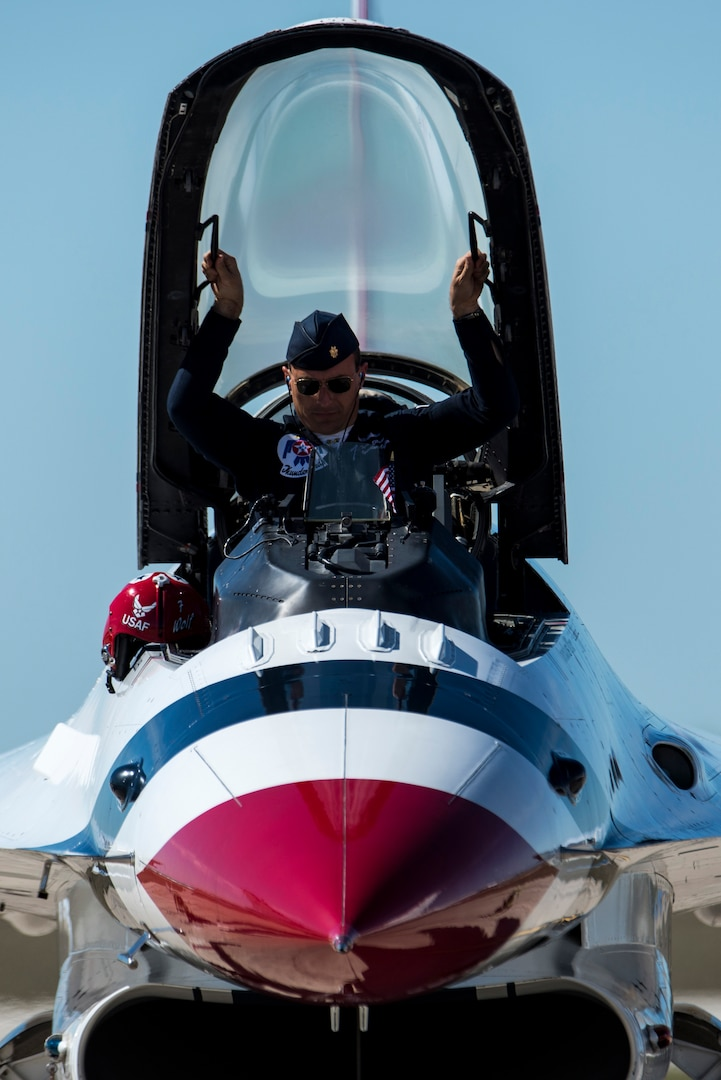 """Maj. Tyler Ellison, U.S. Air Force Air Demonstration Squadron """"Thunderbirds"""" operations officer, opens the canopy of his F-16 Fighting Falcon Oct. 27, 2015 at Joint Base San Antonio-Randolph, Texas. The Thuderbirds perform aerial demonstrations to highlight the unique capabilities of American military services, while showcasing the world's most technologically advanced air and space force capabilities."""