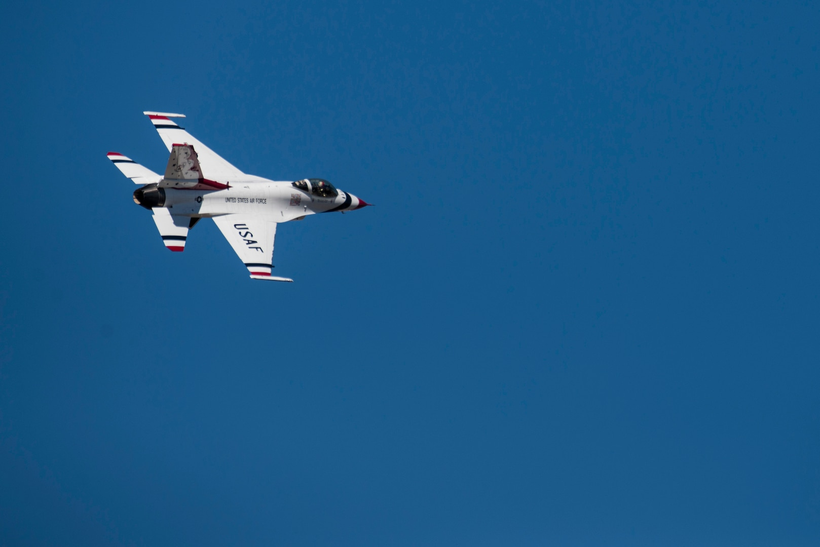 """A member of the U.S. Air Force Aerial Demonstration Squadron """"Thunderbirds"""" flies over Joint Base San Antonio-Randolph Oct. 26, 2015. The Thuderbirds perform aerial demonstrations to highlight the unique capabilities of American military services, while showcasing the world's most technologically advanced air and space force capabilities."""