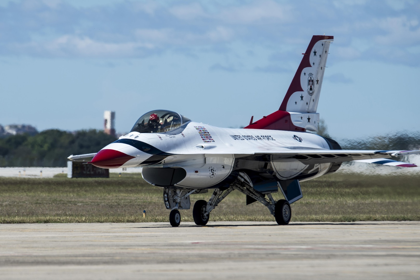 """U.S. Air Force Aerial Demonstration Squadron """"Thunderbirds"""" team members arrive at Joint Base San Antonio-Randolph prior to the 2015 Joint Base San Antonio air show and open house Oct. 26, 2015.  Air shows allow the Air Force to display the capabilities of our aircraft to the American taxpayer through aerial demonstrations and static displays.  The air show will allow attendees to get up close and personal to see some of the equipment and aircraft used by the U.S. military today."""