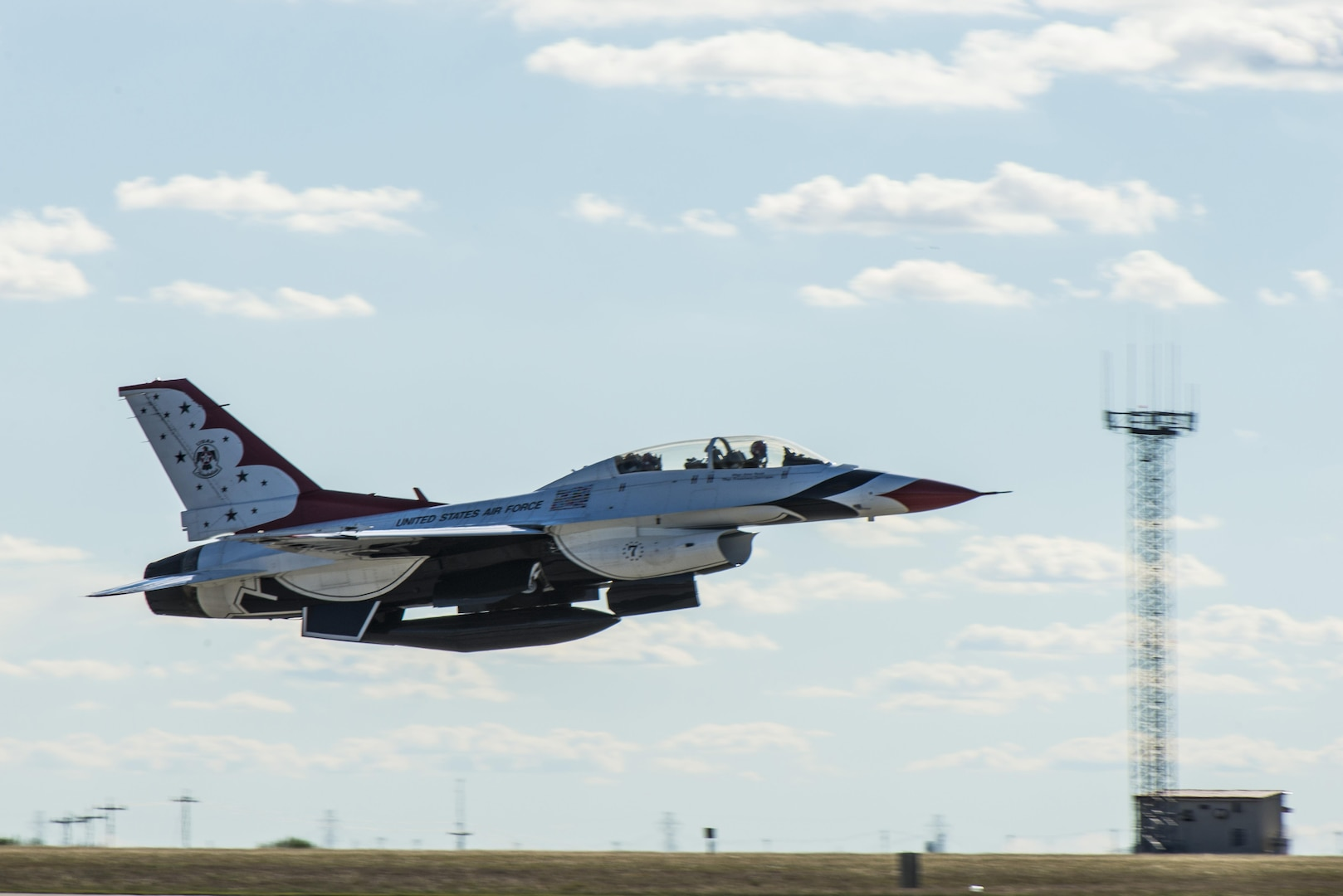 """Maj. Tyler Ellison, U.S. Air Force Air Demonstration Squadron """"Thunderbirds"""" operations officer takes off from Joint Base San Antonio-Randolph Oct. 26, 2015. The Thunderbirds perform for people all around the world, combining years of training and experience with an attitude of excellence to showcase what the Air Force is all about."""