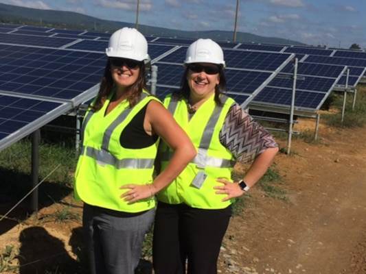 (Left to right) Charlene Woods, DLA Energy Installation Energy contract specialist, and Cindy Ralph, DLA Energy Installation Energy contracting officer, pose for a photograph after conducting a site visit at the solar array being constructed at Fort Detrick, Maryland.