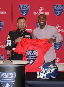 Staff Sgt. Armando Santana, recruiter with Recruiting Sub Station Thousand Oaks, presents Theo Howard with a jersey for the 2016 Semper Fidelis All-American Bowl at Westlake High School in Westlake Village, Oct. 8, 2015. (Courtesy photo)