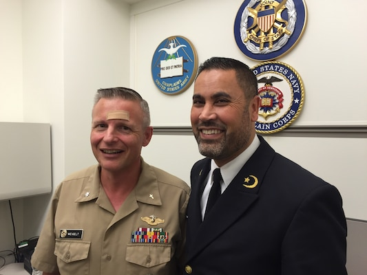 Dutch Navy Capt. (Chaplain) Ali Eddouadi visits with Navy Cmdr. (Chaplain) Brian Weigelt in the Joint Staff chaplain's office in the Pentagon, Oct. 23, 2015. Eddouaddi, a Muslim chaplain, is visiting his counterparts in Canada and the United States to build a network to help in countering the message of the Islamic State of Iraq and the Levant and to find ways to work together in normal settings. DoD photo by Jim Garamone