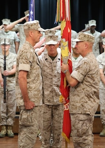 """Lieutenant Gen. Kenneth F. McKenzie, Jr., prepares to relinquish command of U.S. Marine Corps Forces Central Command to Lt. Gen. Dave """"Smoke"""" Beydler during a change of command ceremony at the Surf's Edge aboard Air Force Base MacDill, Oct. 27, at 9:00 a.m. Sergeant Maj. Larry Fineran, MARCENT sergeant major, salutes after passing the MARCENT battle colors to McKenzie, who in turn would hand the colors over to Beydler symbolizing the transfer of command.  General Robert B. Neller, 37th Commandant of the Marine Corps, presided over the ceremony."""