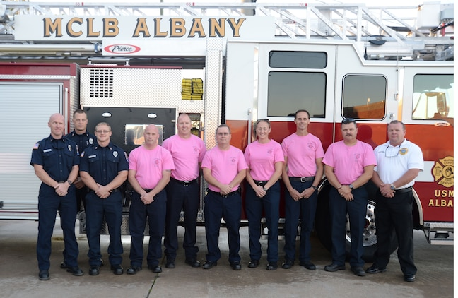 "In support of the fight against breast cancer, several emergency medical technicians/firefighters and paramedics at Marine Corps Logistics Base Albany trade their usual uniforms-of-the-day for pink T-shirts during the month of October. Fire Department personnel have made it an annual tradition to participate in the nation's ""Think Pink"" campaign in efforts of finding a cure for the disease."