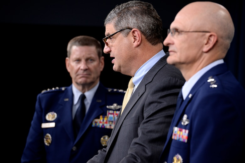 Dr. Bill LaPlante, the assistant secretary of the Air Force for acquisition, answers questions after Secretary of the Air Force Deborah Lee James and Air Force Chief of Staff Gen. Mark A. Welsh III announced he award of the long range strike bomber contract in the Pentagon during a press briefing, Oct. 27, 2015.  With LaPlante are Gen. Robin Rand, commander of Air Force Global Strike Command, and Lt. Gen. Arnold Bunch Jr., the military deputy for the Office of the Assistant Secretary of the Air Force for Acquisition.  (U.S. Air Force photo/Scott M. Ash)