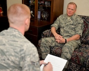 Chief Master Sgt. of the Air Force James A. Cody shares insight about Air Force issues with Airman 1st Class Curt Beach, 2nd Bomb Wing Public Affairs photojournalist, at Barksdale Air Force Base, La., Oct. 22, 2015. Cody represents the highest enlisted level of leadership, and as such, provides direction for the enlisted force and represents their interests, as appropriate, to the American public, and to those in all levels of government. (U.S. Air Force photo/Airman 1st Class Mozer O. Da Cunha)