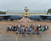 Motorcyclists pose for a group photo in front of two B-52 Stratofortresses on Barksdale Air Force Base, La., Oct. 23, 2015. More than 30 riders gathered for a safety brief and group photo celebrating the fourth annual Cajun Rumble hosted by the Green Knights Motorcycle Club Chapter 75. (U.S. Air Force photo/Airman 1st Class Mozer O. Da Cunha)