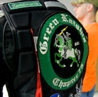 A patched member from the Green Knights Motorcycle Club Chapter 75 attend a safety briefing, kicking off the fourth annual Cajun Rumble at Barksdale Air Force Base, La., Oct. 23, 2015. The first chapter of the Green Knights was formed in 1999, and today there are more than 105 chapters worldwide. (U.S. Air Force photo/Airman 1st Class Mozer O. Da Cunha)