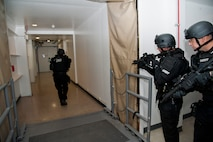 CHEYENNE MOUNTAIN AIR FORCE STATION, Colo. – El Paso County Sheriff's Swat Team monitors the outside of a mission center during an active shooter turned hostage exercise scenario in Cheyenne Mountain Air Force Station's underground complex, Oct. 22, 2015. The joint exercise was intended to evaluate the partnership between Cheyenne Mountain AFS personnel and El Paso County Sheriff's office in a training environment in preparation for future potential real world situations. (U.S. Air Force photo by Senior Airman Tiffany DeNault)