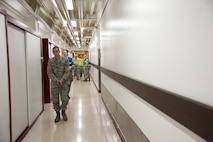 CHEYENNE MOUNTAIN AIR FORCE STATION, Colo. – First Lt. Miles Tran, simulated active shooter, roams the halls of Cheyenne Mountain Air Force Station underground complex leaving mock victims during an exercise, Oct. 22, 2015. Part of the exercise was intended to overwhelm the medical staff into a triage situation with simulated victims scattered along the complex's hallways. (U.S. Air Force photo by Senior Airman Tiffany DeNault)