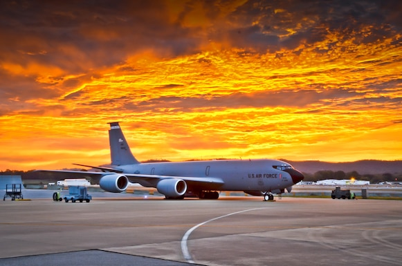 A KC-135R Stratotanker at the 117th Air Refuelling Wing, Birmingham, Alabama welcomes a fiery sunrise on October 24, 2015 . (U.S. Air National Guard photo illustration by: Senior Master Sgt. Ken Johnson/Released)